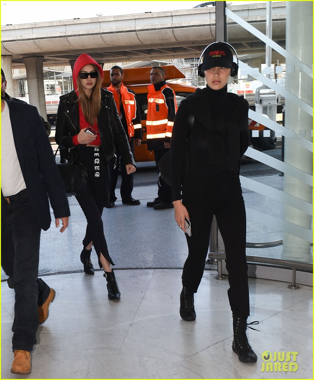 gigi and bella hadid coordinate their looks while arriving back in nyc 044076951