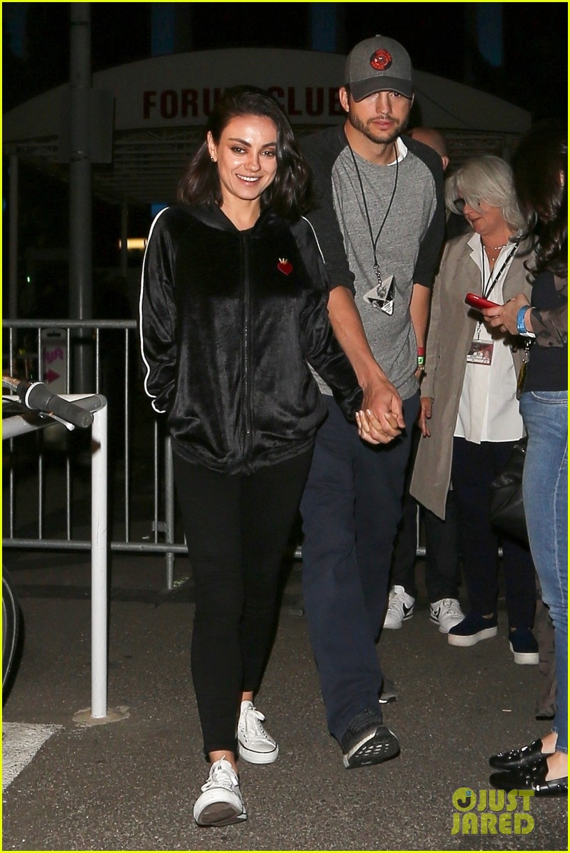 mila kunis ashton kutcher step out for date night at u2 concert 084085052