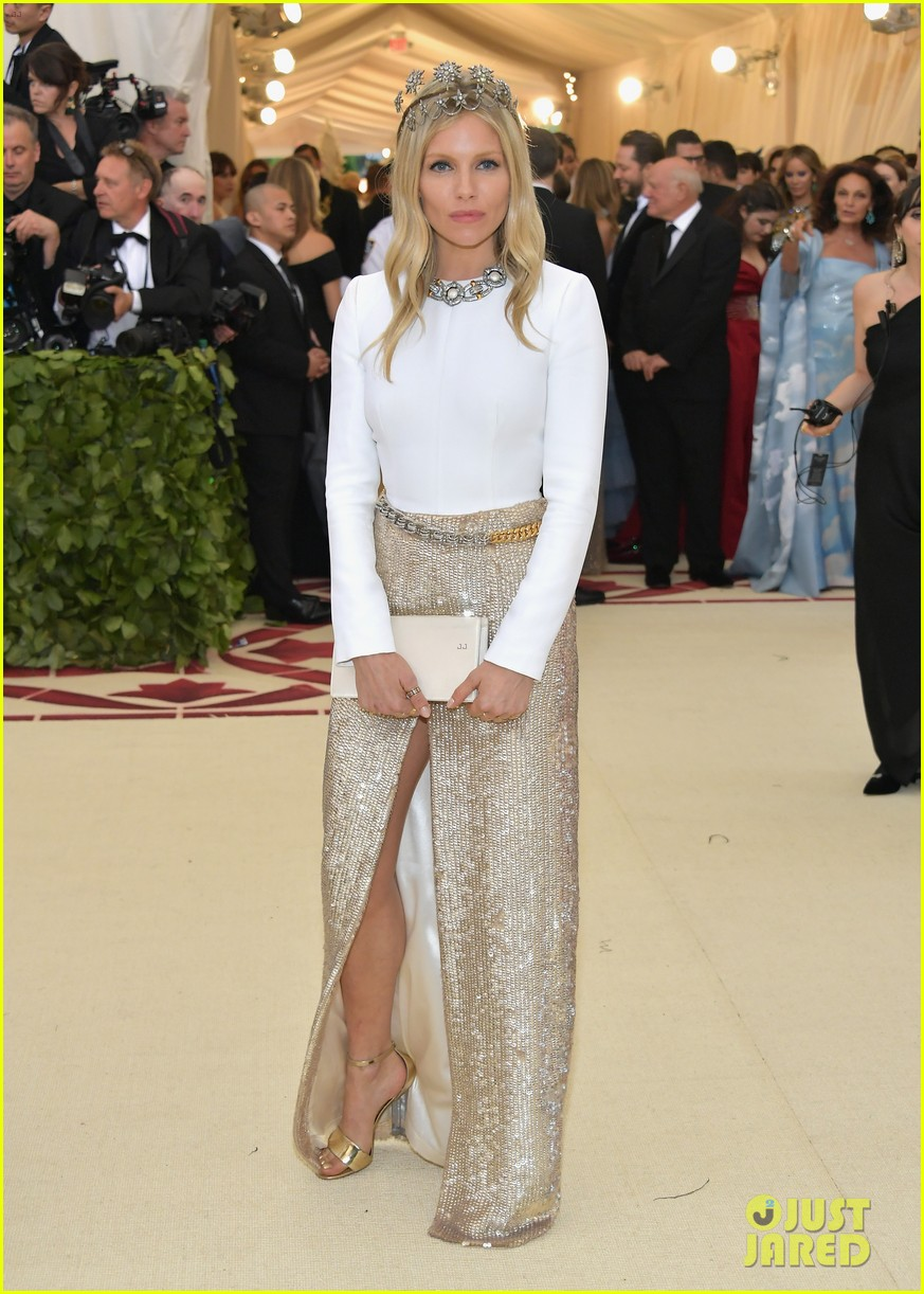 Sienna Miller Shimmers In Silver Amp Gold At Met Gala 2018