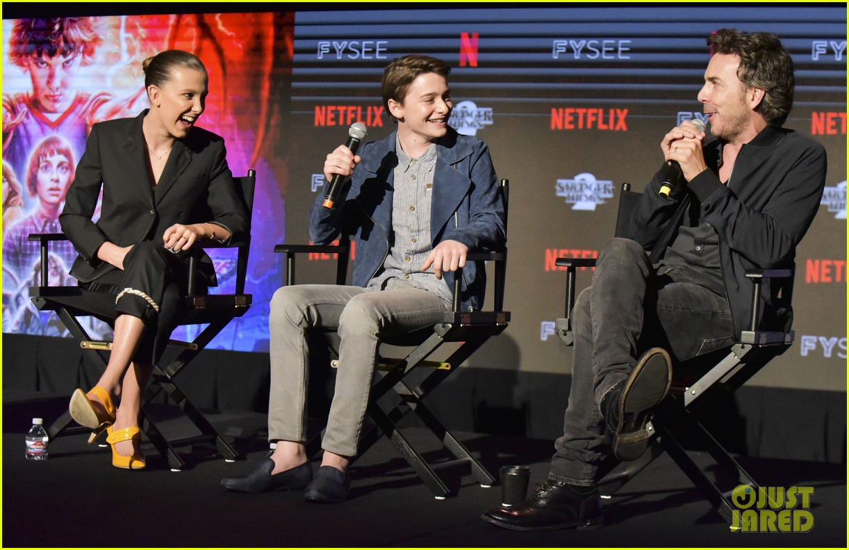 millie bobby brown naoh schnapp hold hands at stranger things panel 064087115