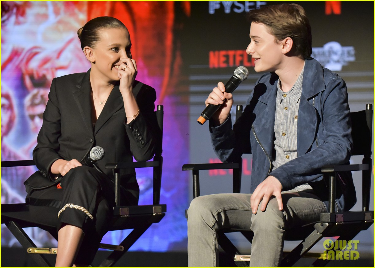 millie bobby brown naoh schnapp hold hands at stranger things panel 104087119