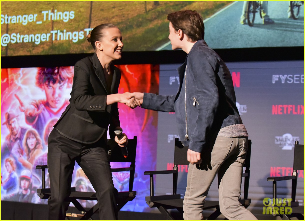millie bobby brown naoh schnapp hold hands at stranger things panel 124087121