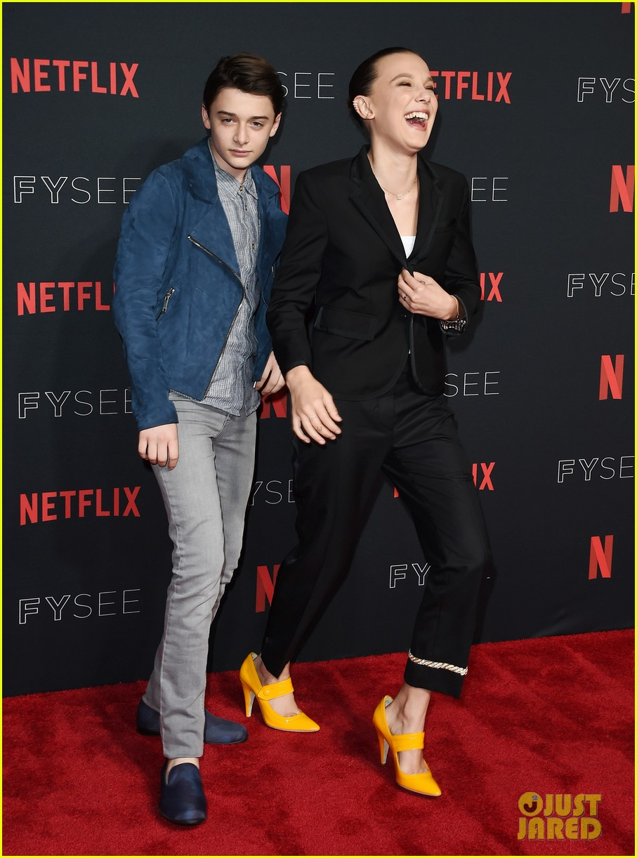 millie bobby brown naoh schnapp hold hands at stranger things panel 174087126