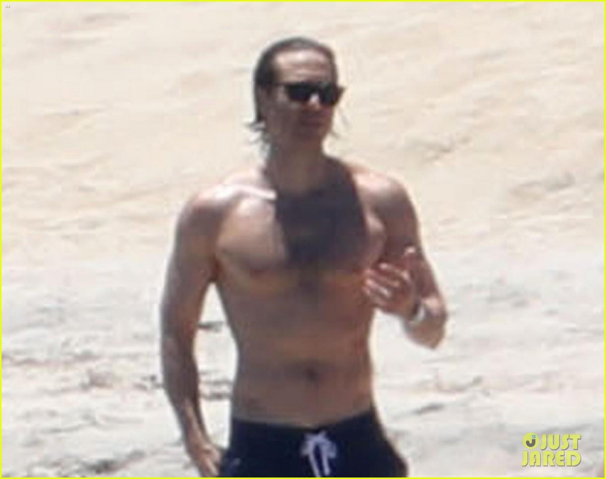 gwyneth paltrow amp brad falchuk sun themselves on the beach