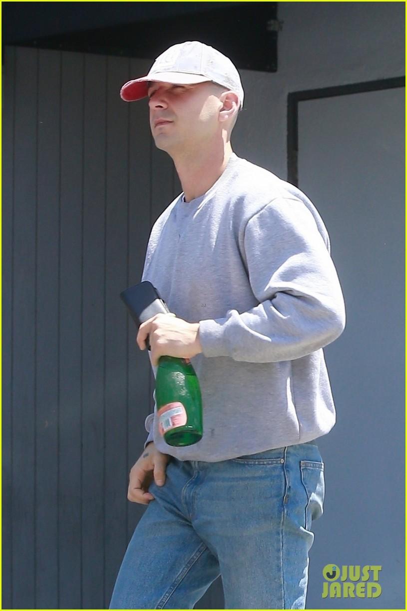 shia labeouf puts bald head on display while running errands photo
