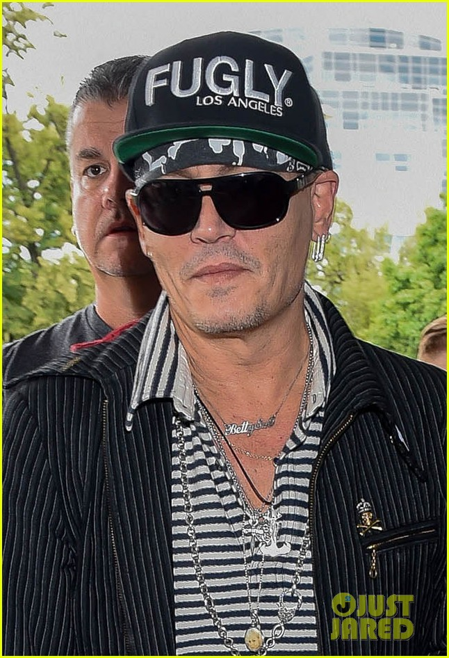 johnny depp greets fans while arriving at poland airport 014101148