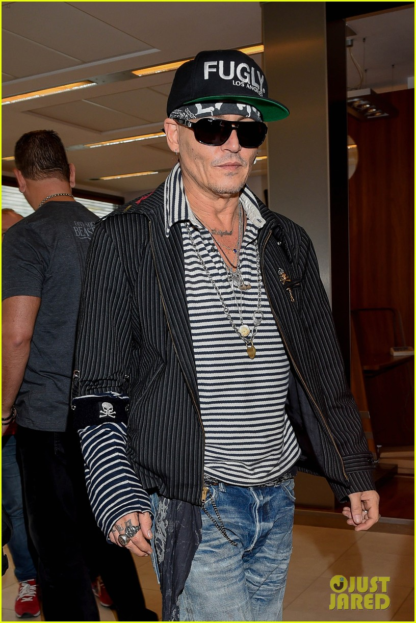 johnny depp greets fans while arriving at poland airport 024101149