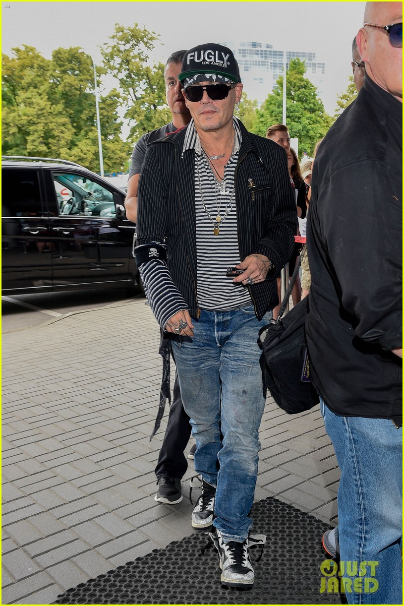 johnny depp greets fans while arriving at poland airport 054101152