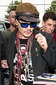 johnny depp greets fans while jetting out of germany 01