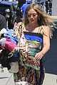 hilary duff dresses her baby bump in colorful dress 01