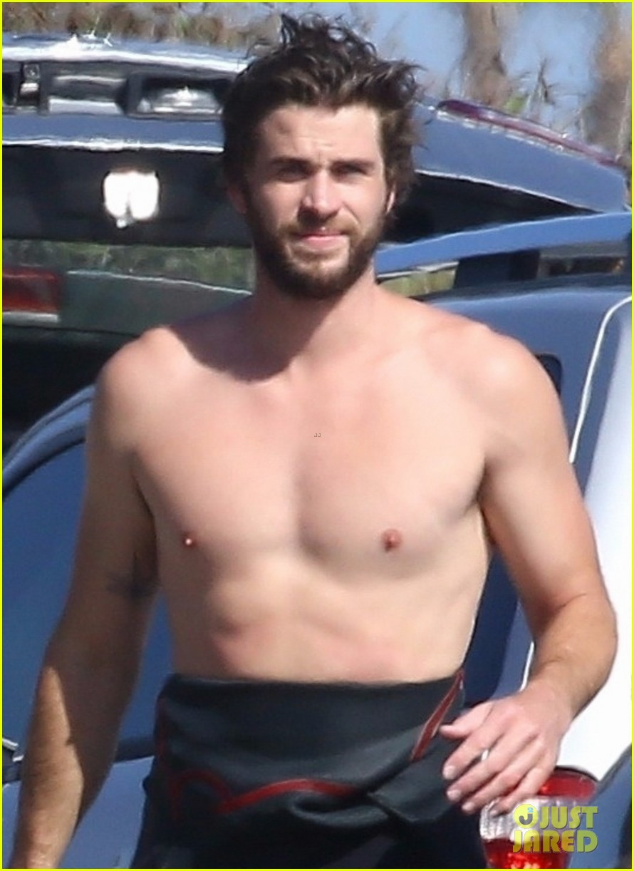 liam hemsworth goes shirtless after surfing session 024100580