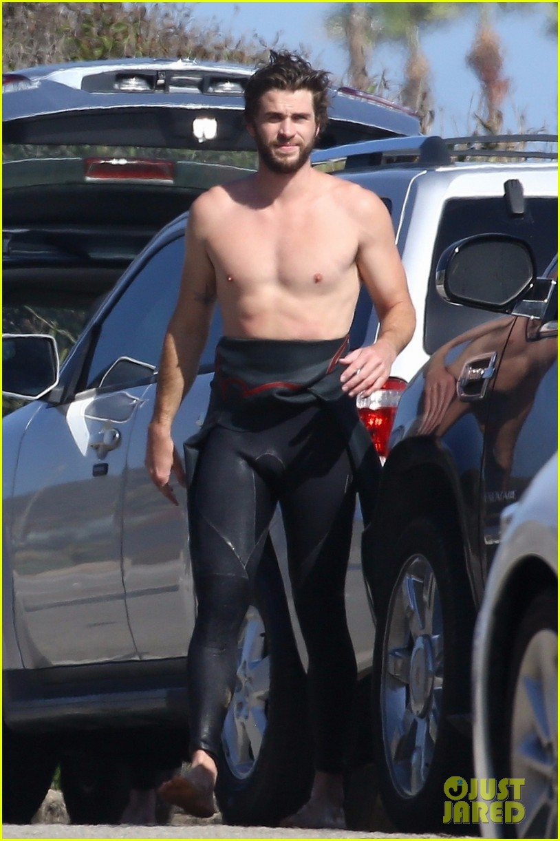 liam hemsworth goes shirtless after surfing session 064100584