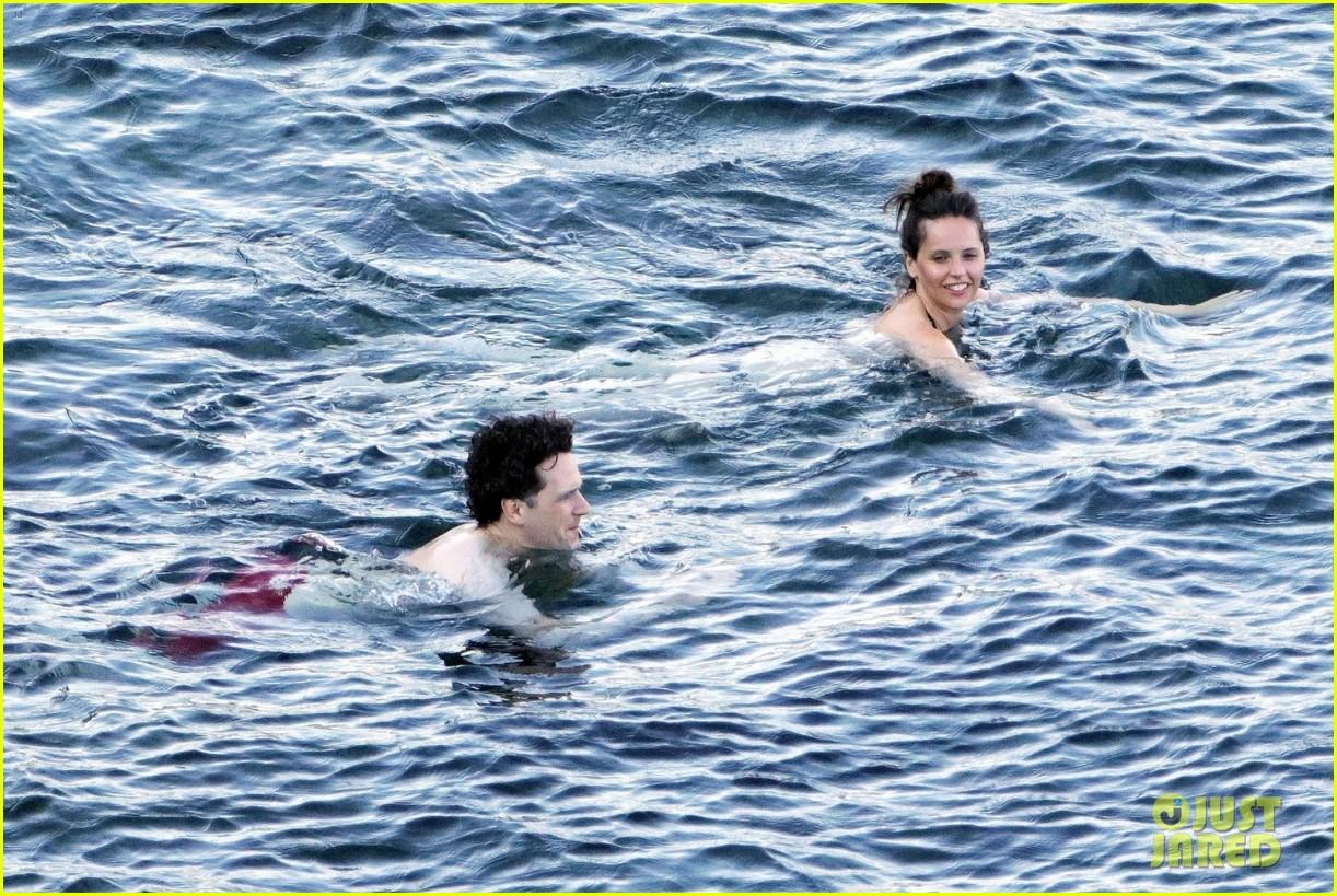 felicity jones charles guard hit the beach honeymoon 144114100
