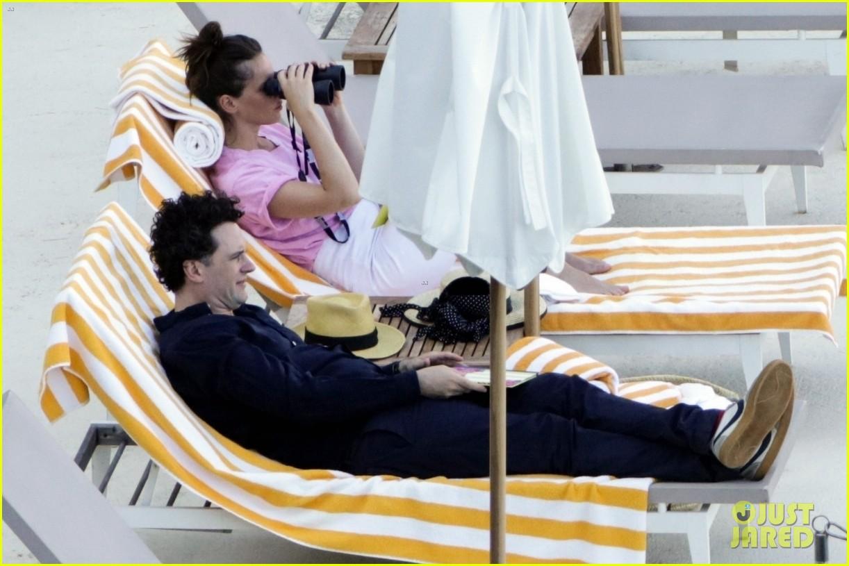felicity jones charles guard hit the beach honeymoon 184114104
