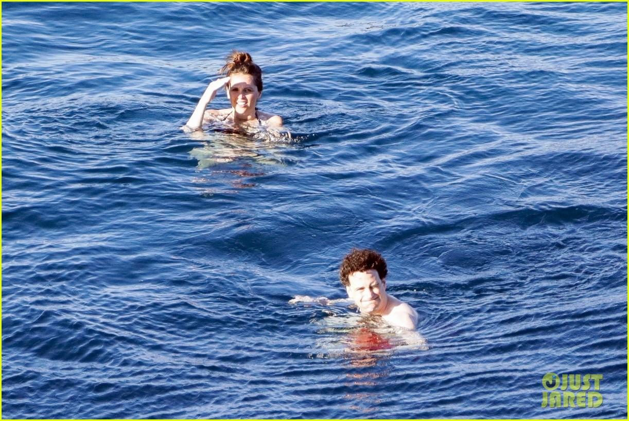 felicity jones charles guard hit the beach honeymoon 304114116
