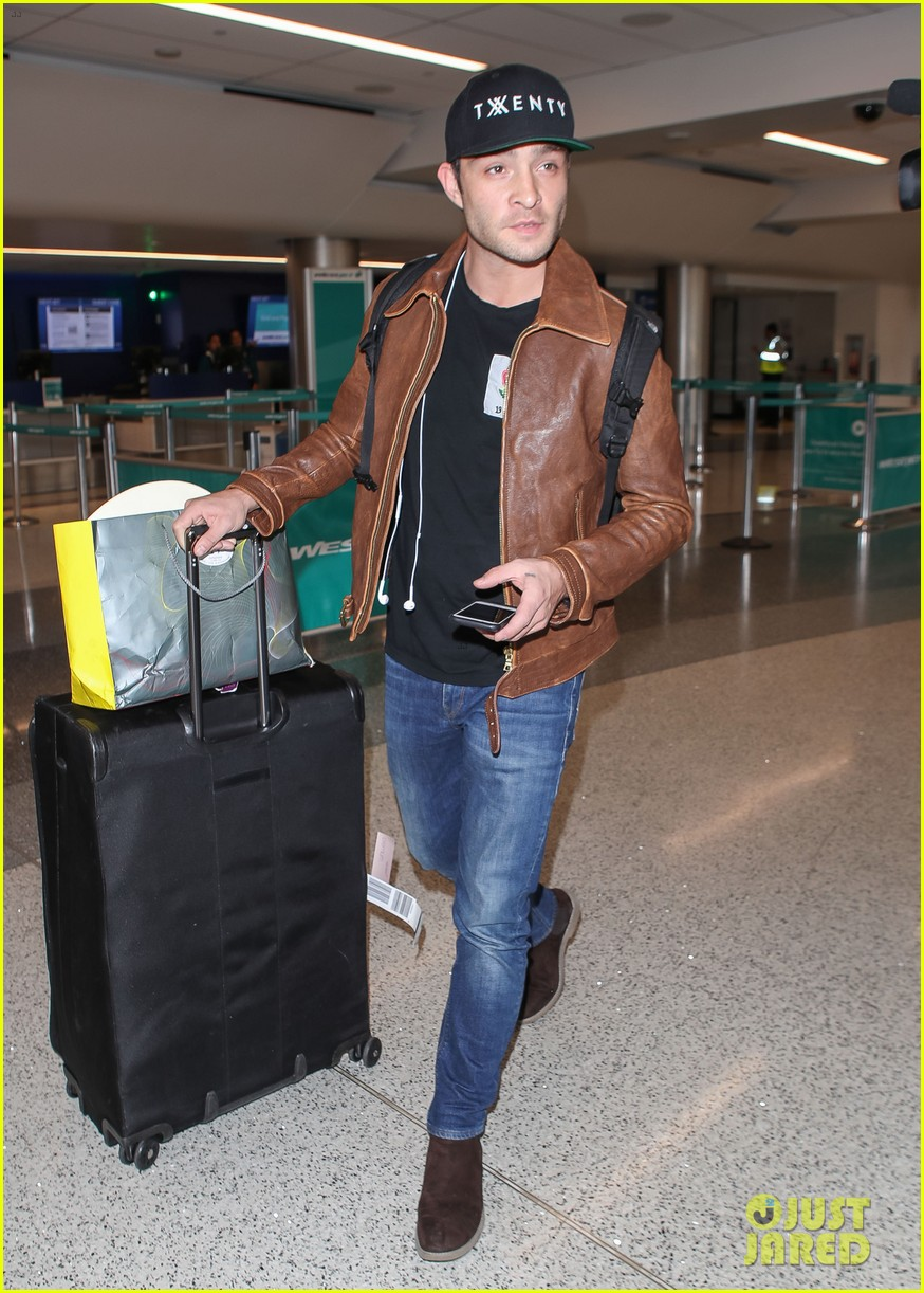 ed westwick is all smiles jetting out of lax airport 01