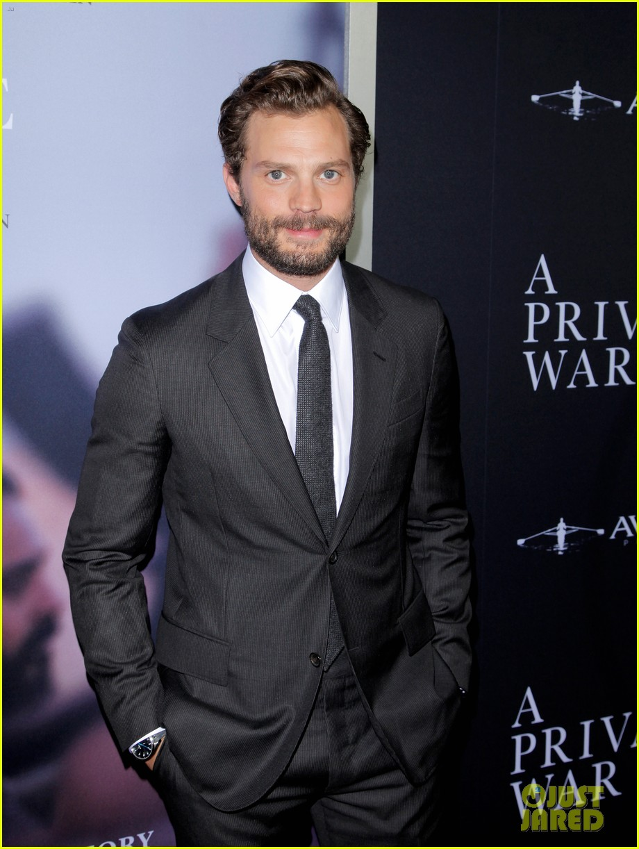 jamie dornan rosamund pike step out for a private war los angeles premiere 024170229