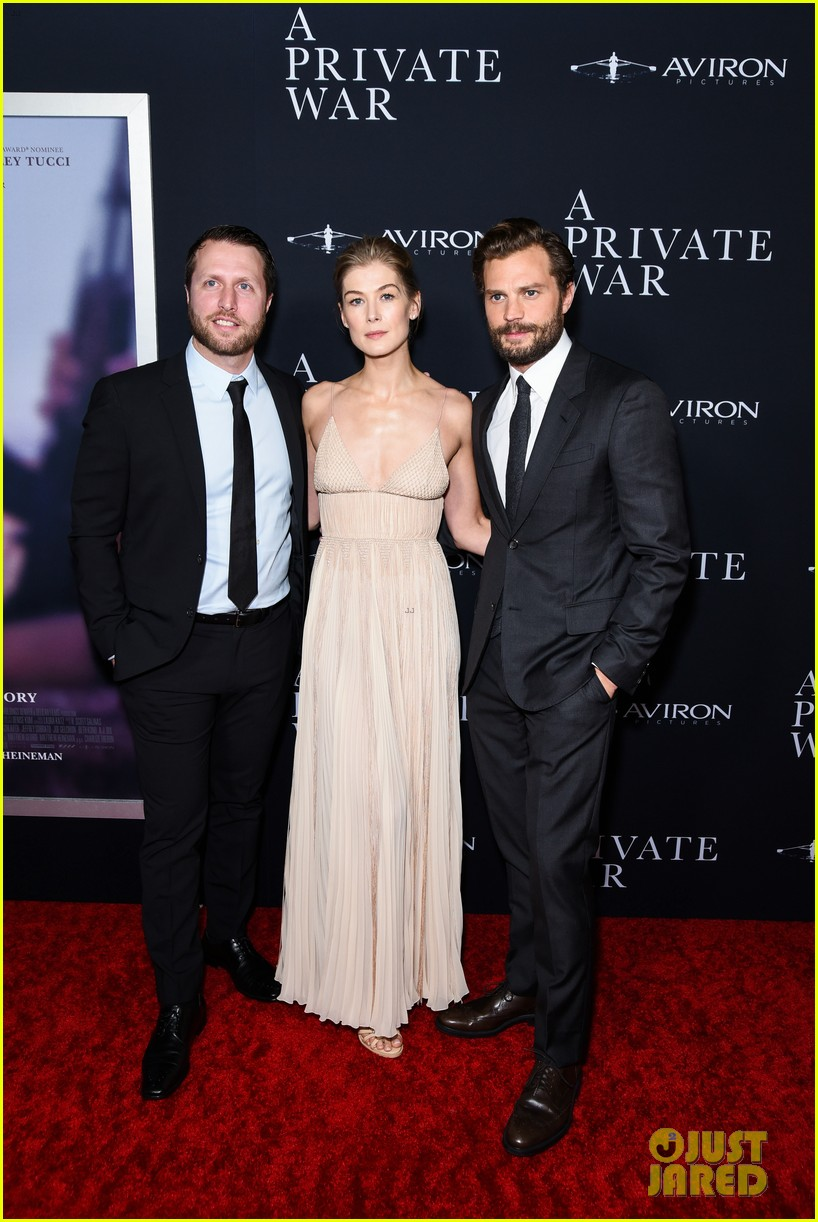 jamie dornan rosamund pike step out for a private war los angeles premiere 034170230