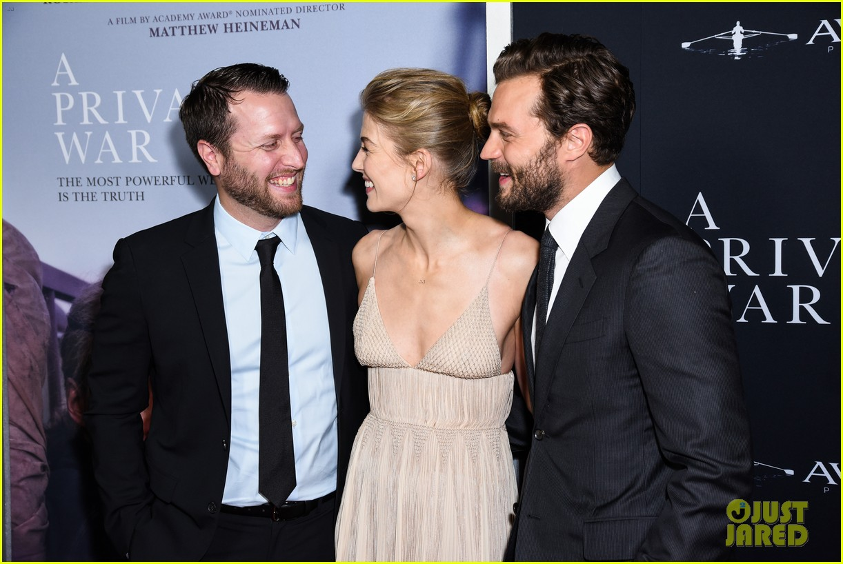 jamie dornan rosamund pike step out for a private war los angeles premiere 054170232