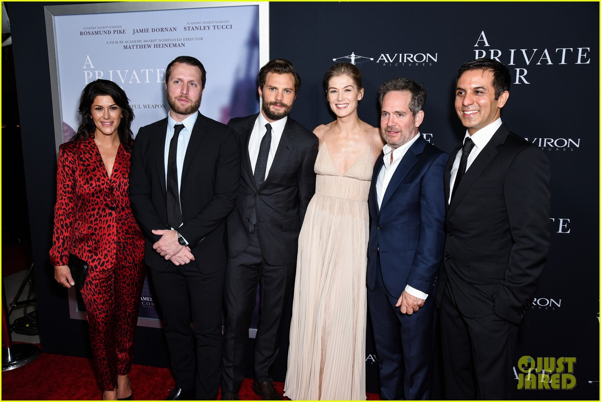 jamie dornan rosamund pike step out for a private war los angeles premiere 084170235