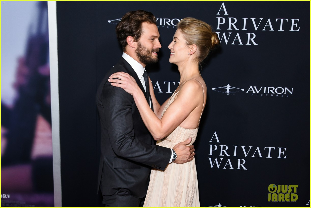 jamie dornan rosamund pike step out for a private war los angeles premiere 254170252