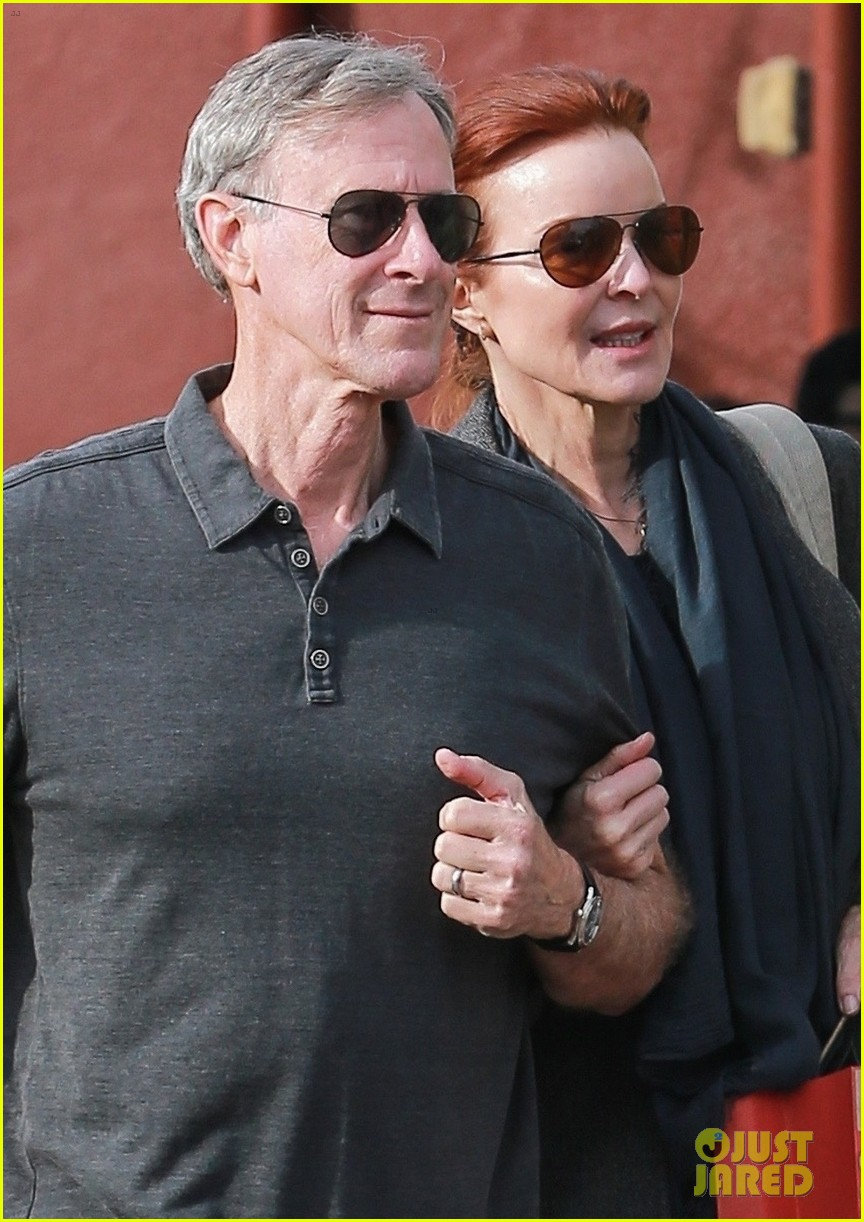 marcia cross holds on tight to husband tom mahoney 02
