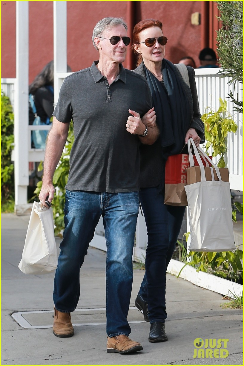 marcia cross holds on tight to husband tom mahoney 03