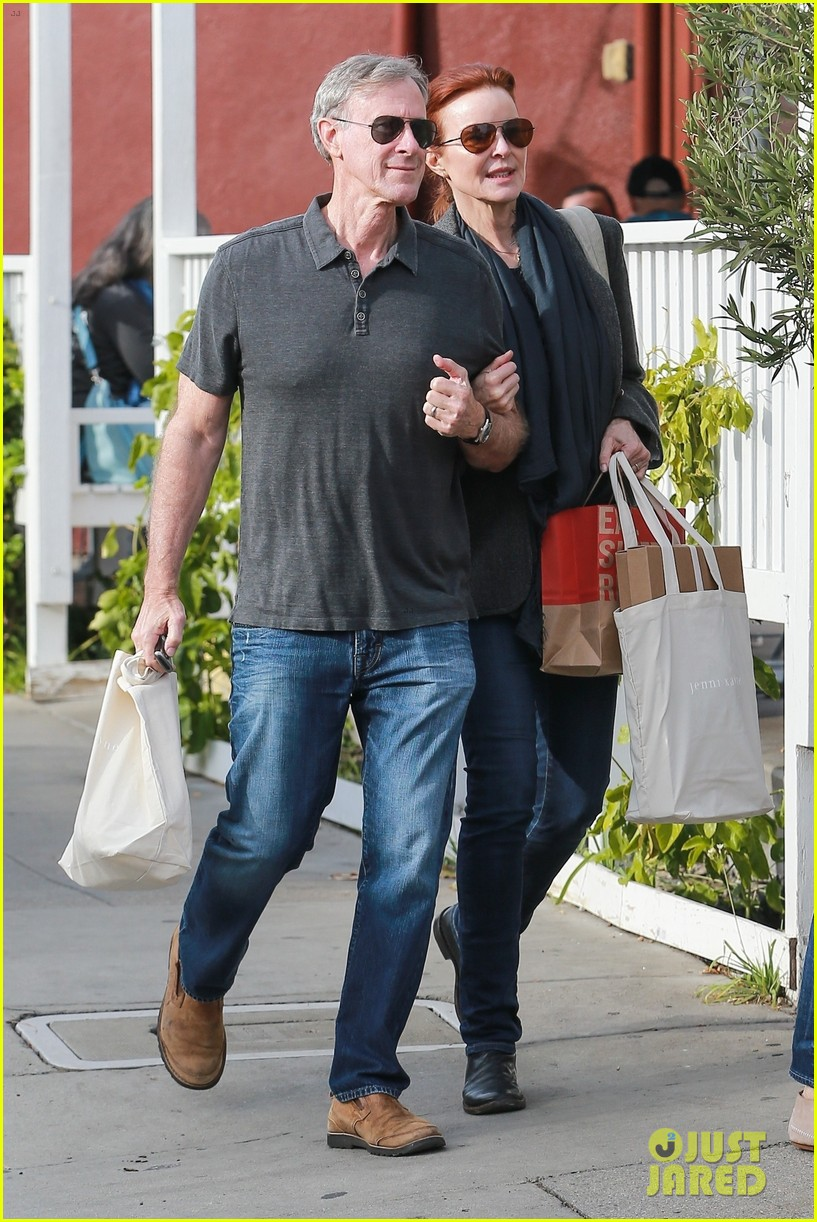 marcia cross holds on tight to husband tom mahoney 05