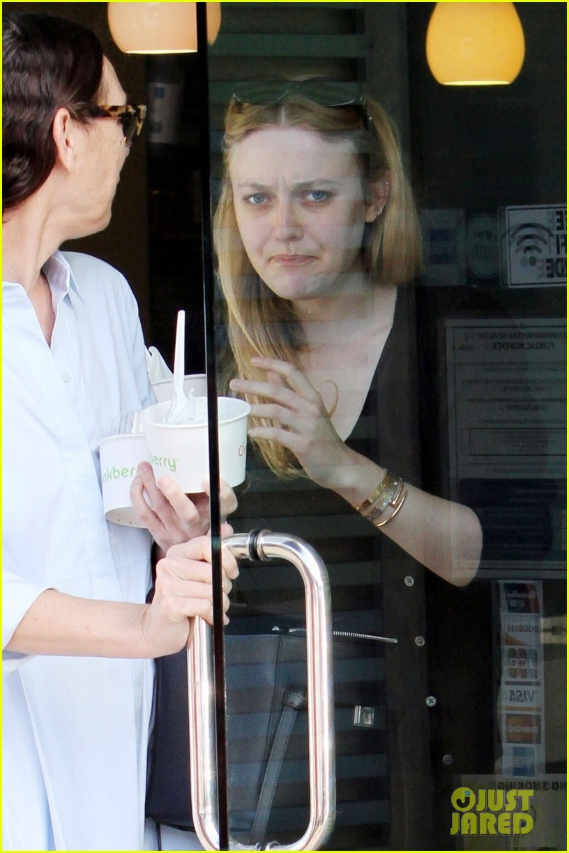 dakota fanning dons black dress for froyo date with her