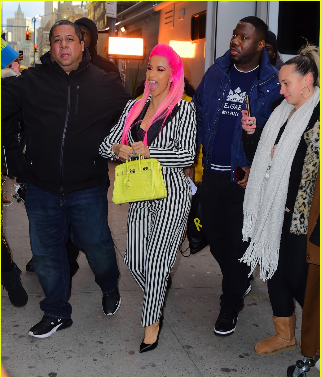 cardi b sports pink hair with striped suit for rhythm and flow filming 01