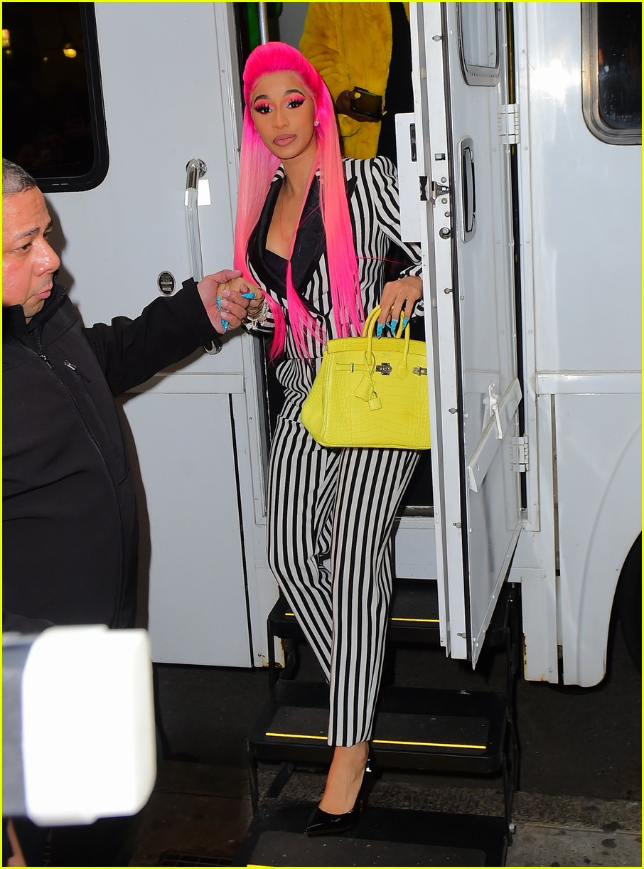 cardi b sports pink hair with striped suit for rhythm and flow filming 02