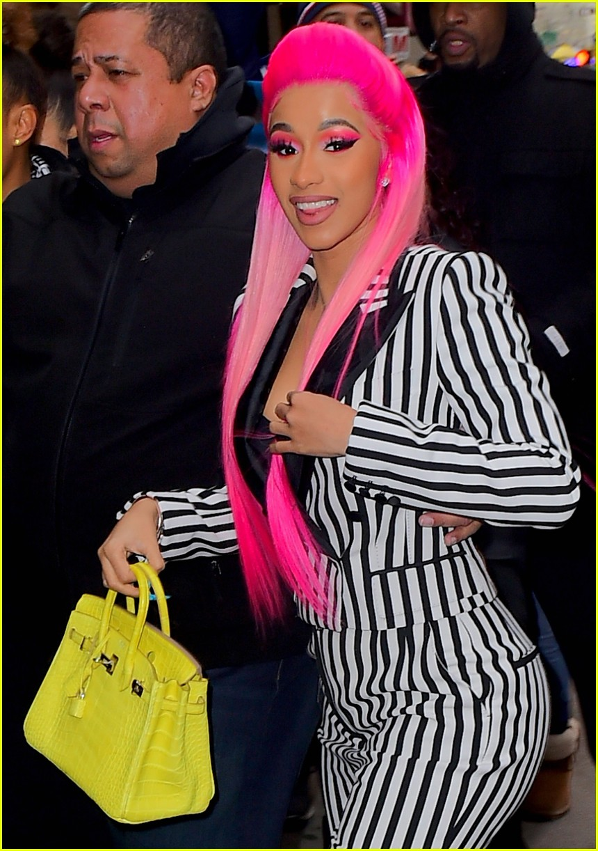 cardi b sports pink hair with striped suit for rhythm and flow filming 03