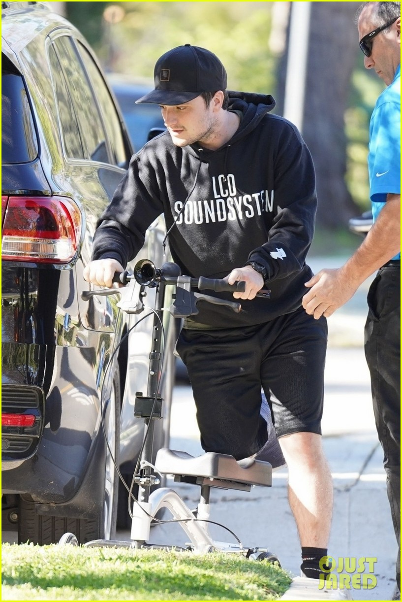 josh hutcherson makes a coffee run on his injured leg 04