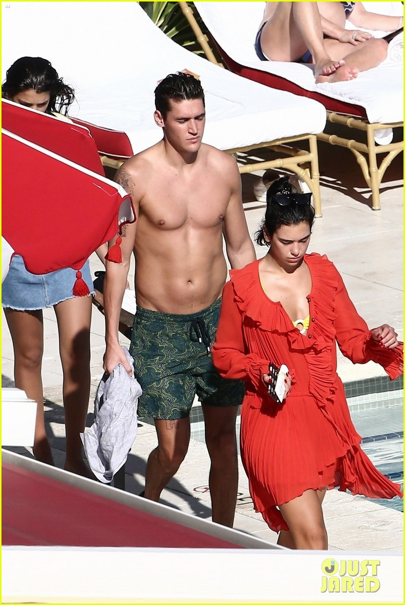 dua lipa boyfriend isaac carew lounge by the pool in miami 034204312