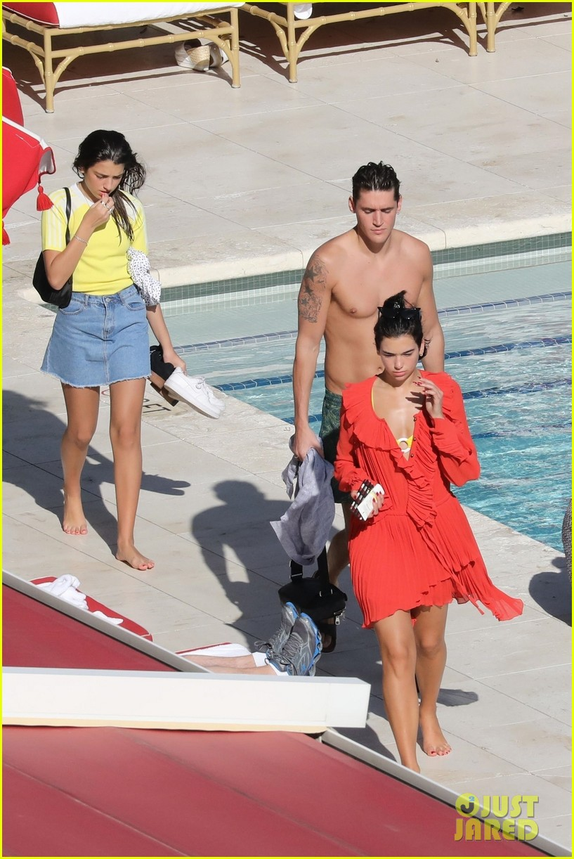 dua lipa boyfriend isaac carew lounge by the pool in miami 044204313