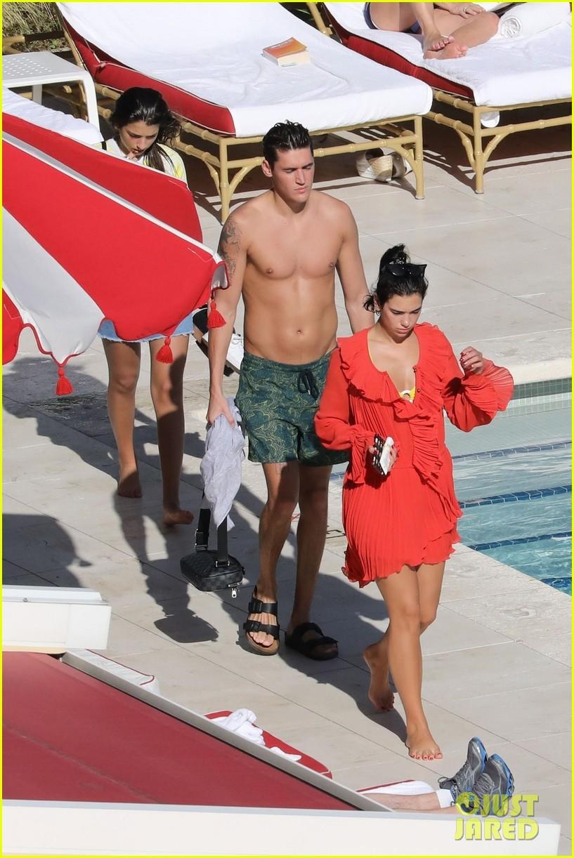 dua lipa boyfriend isaac carew lounge by the pool in miami 064204315