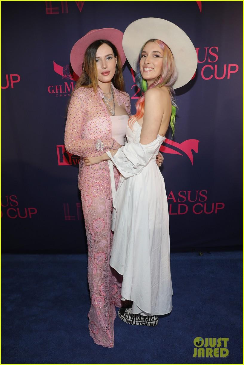 bella thorne poses in sheer pink ensemble pegasus world cup 2019 01