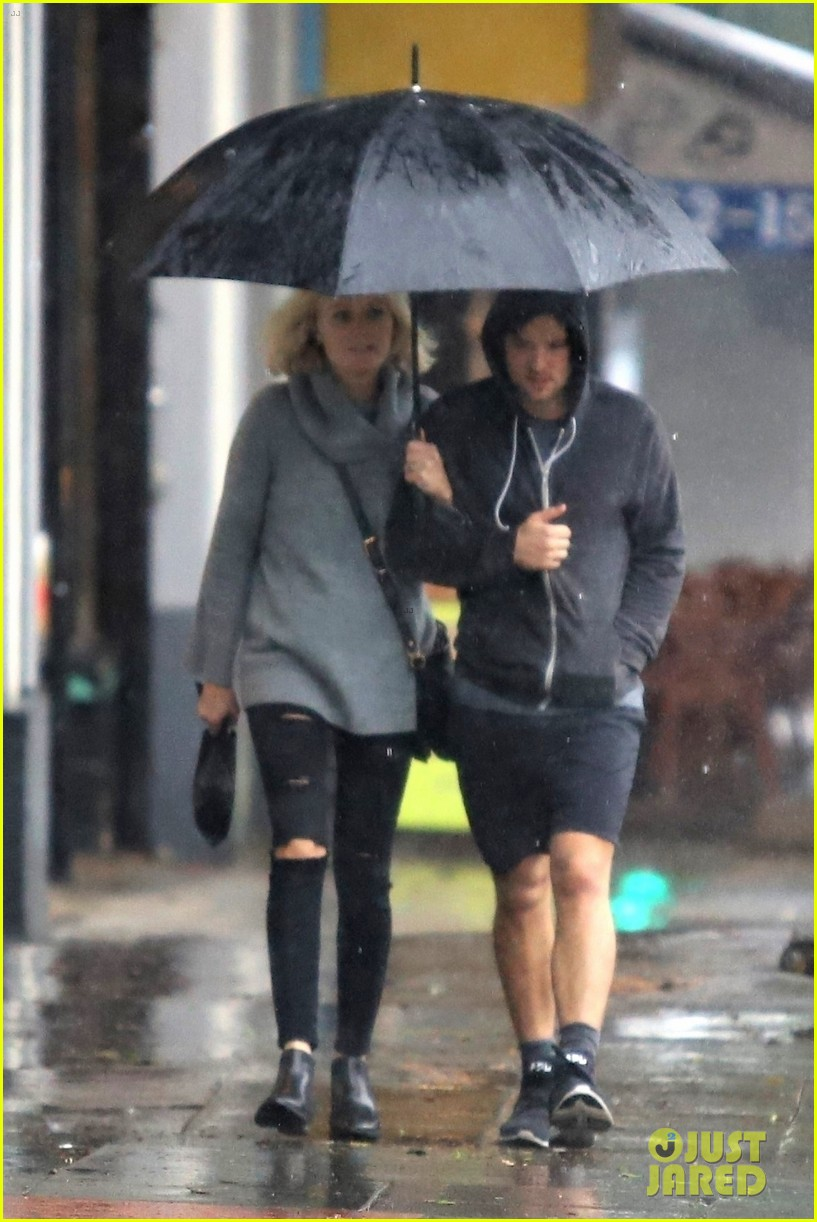 malin akerman braves the downpours with husband jack donnelly 024221271