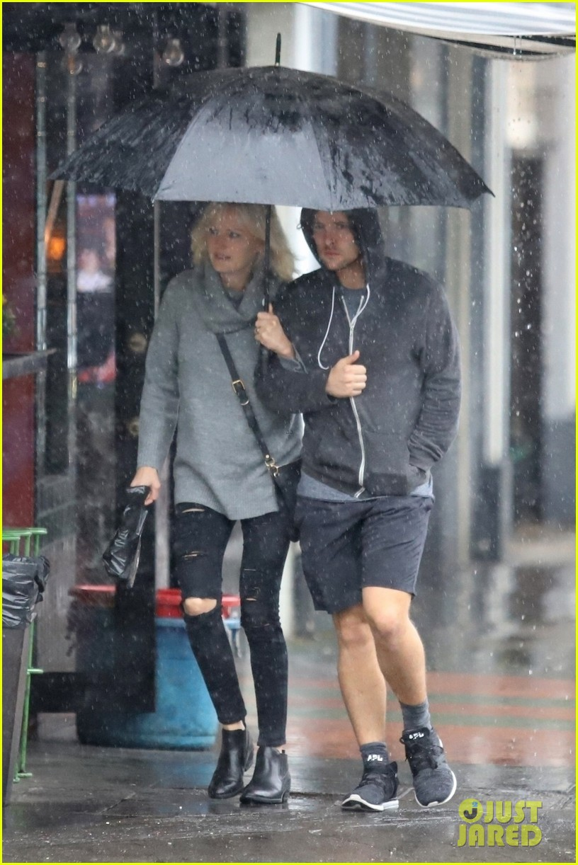 malin akerman braves the downpours with husband jack donnelly 034221272