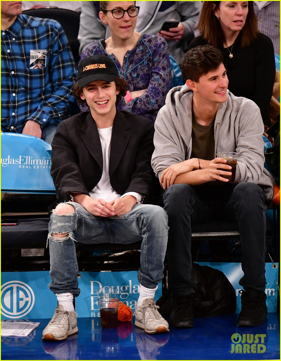 timothee chalamet spills his drink at new york knicks game 01