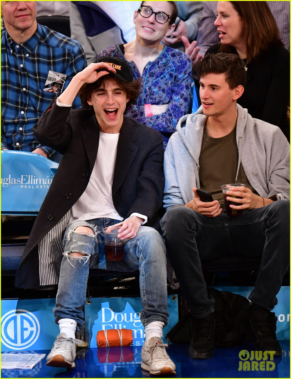 timothee chalamet spills his drink at new york knicks game 03