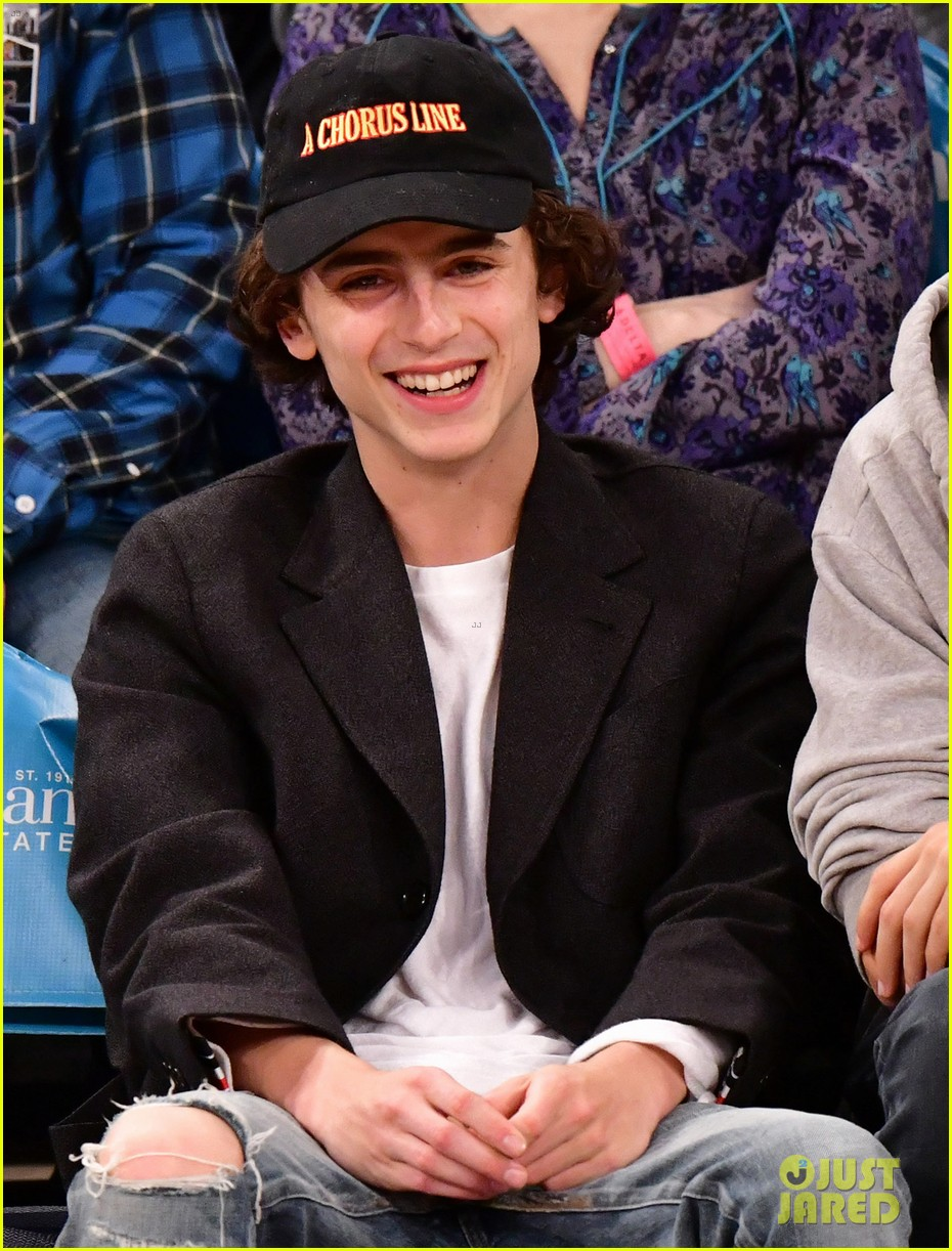 timothee chalamet spills his drink at new york knicks game 04