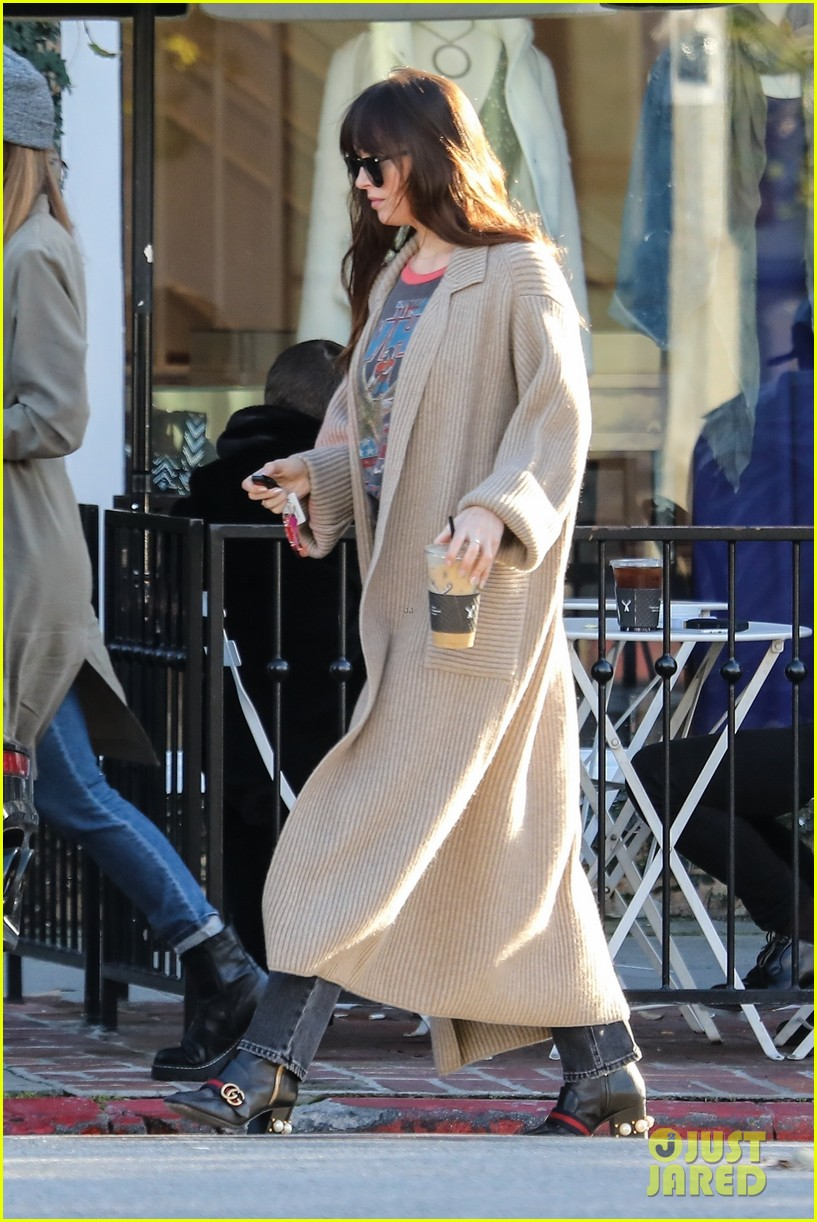 dakota johnson grabs coffee before heading to a meeting 01