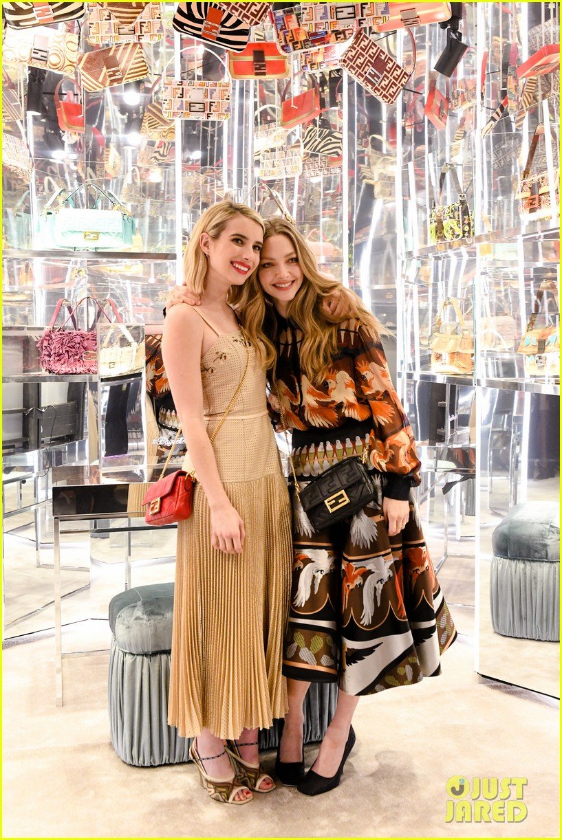 emma roberts amanda seyfried step out for fendi event in nyc 09