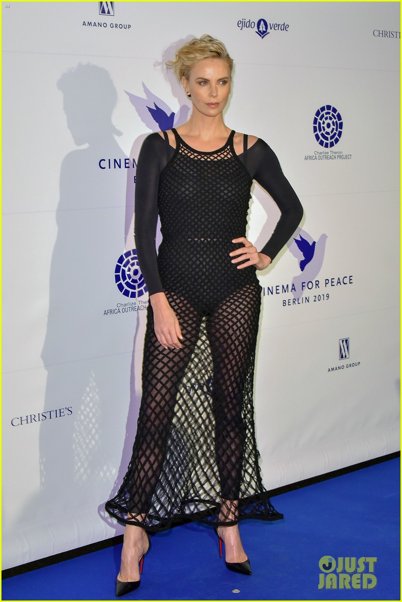 charlize theron supports cinema for peace foundation at berlin film fest 034237996