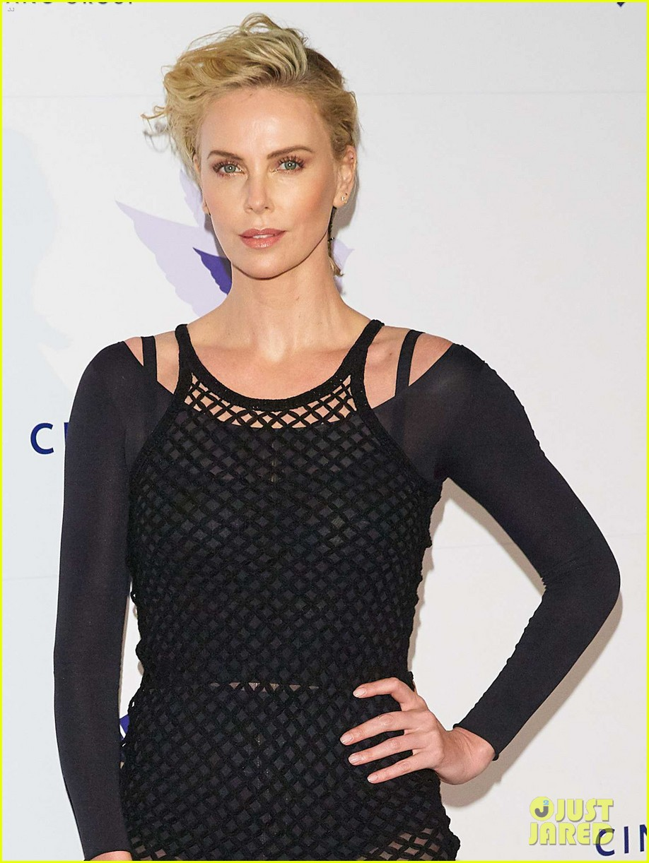 charlize theron supports cinema for peace foundation at berlin film fest 044237997
