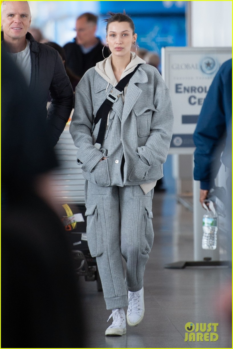 bella hadid bundles up in comfy grey suit while landing in nyc 01
