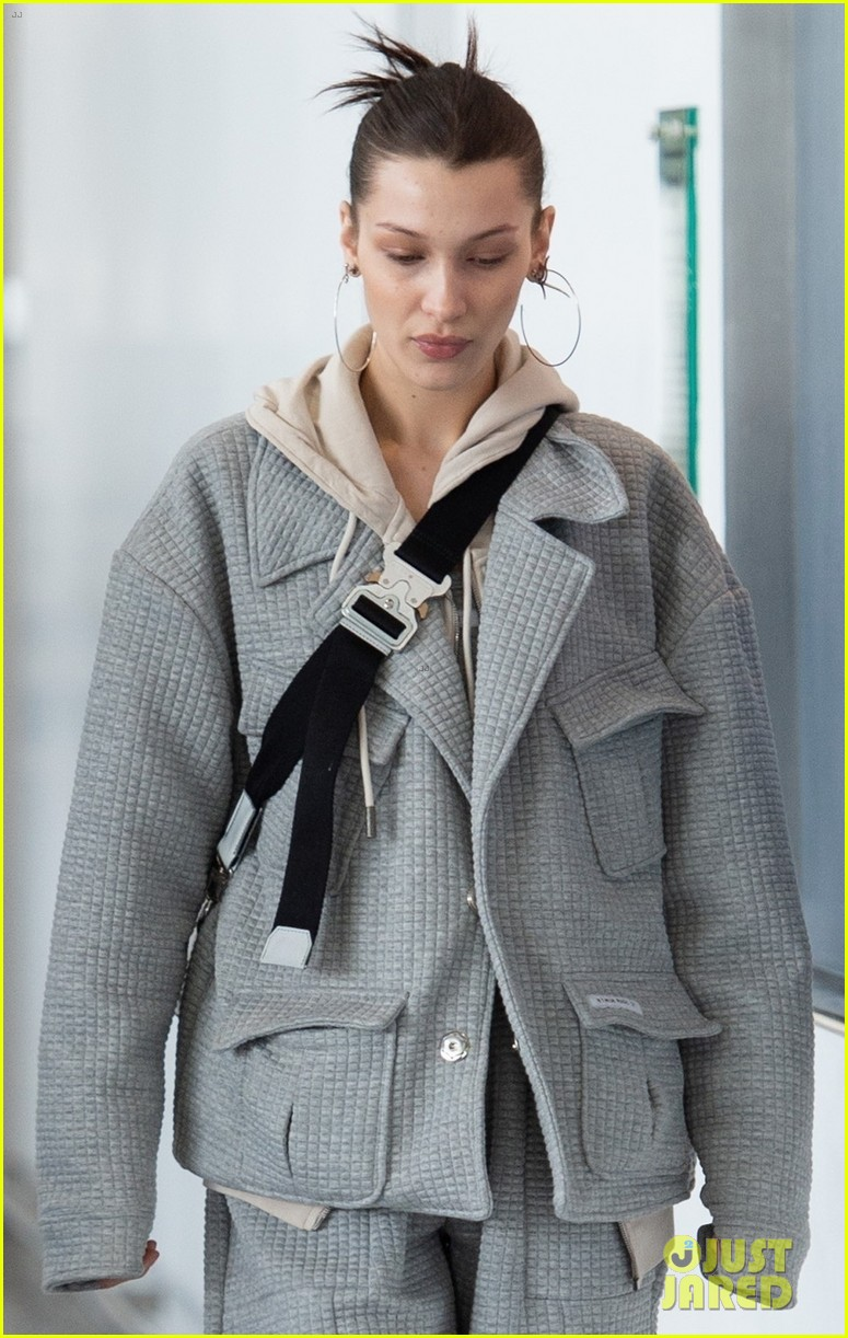 bella hadid bundles up in comfy grey suit while landing in nyc 02