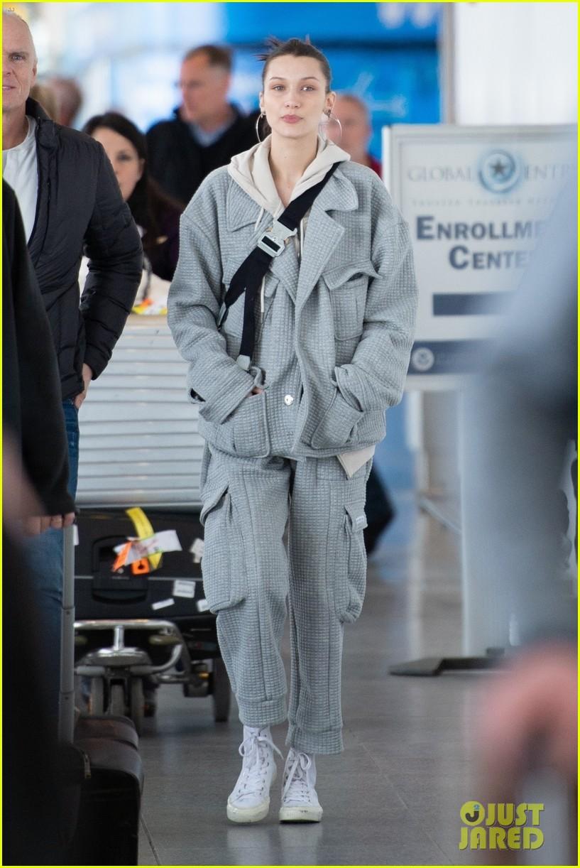 bella hadid bundles up in comfy grey suit while landing in nyc 03
