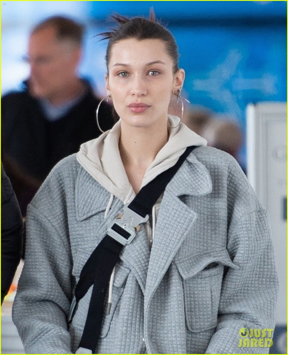 bella hadid bundles up in comfy grey suit while landing in nyc 04